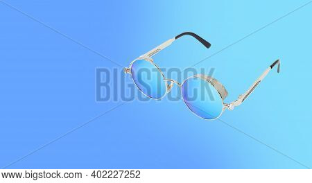 Clothes, Shoes And Accessories - Sunglasses Isolated On A Blue Background.