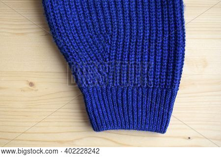 Sweater Sleeve With Cuff.  Knitted Sweater Is Handmade From Wool. Sweater Is Warm And Fashionable Cl