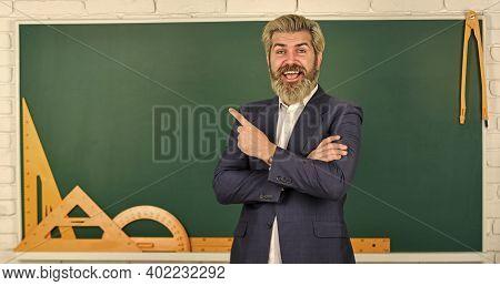 Teacher Explain Hard Topic. Man Teacher In Front Of Chalkboard. Important Information To Remember. T