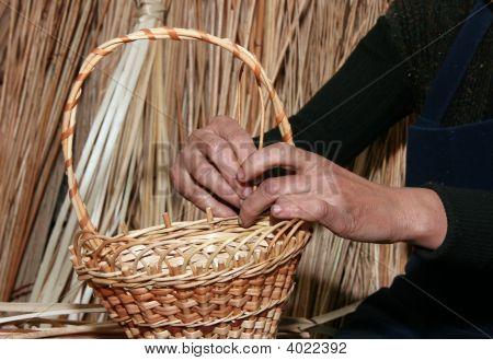 Female Hands Manually Mastering Wicker Basket