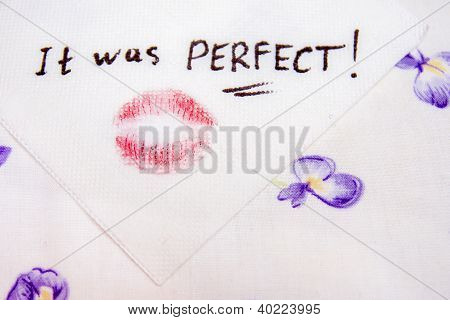 Note on napkin with lipstick kiss over the bed-clothes poster