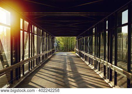 Pedestrian Pathway Above Highway, Golden Light Shining Creating Shadows