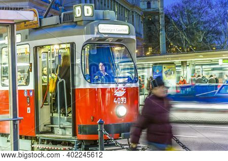 Vienna, Austria - April 23, 2009: People In Blurred Motion Entering The Streetcar In Vienna.