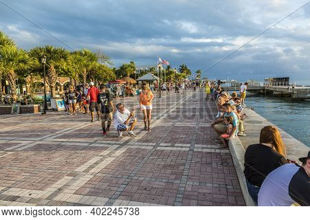 Key West, Usa - August 26, 2014: People Enjoy The Sunset Point At Mallory Square In Key West, Usa. T