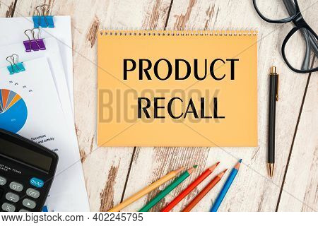 Notebook With The Text Product Recall On The Office Table, Documents, Calculator, Glasses And Pen
