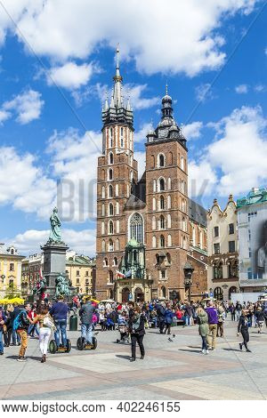 Krakow, Poland - May 4, 2014: Tourists At The Market Square In Krakow . Main Market Square, One Of T