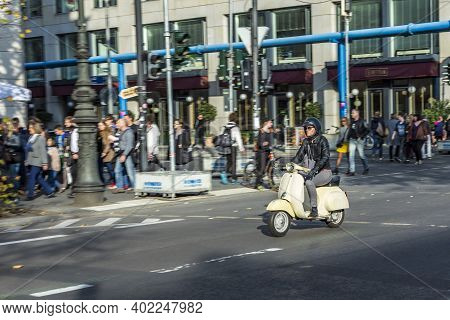 Berlin, Germany - October 27, 2014: Man Enjoys Driving With His Old Historic Motorbike Called Vespa