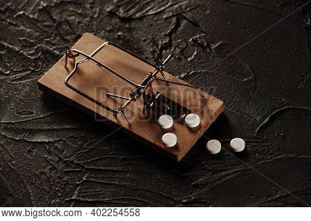 Mousetrap With A Bait In The Form Of Pills. Addiction And Dependence On Drugs