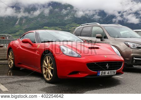 Kinsarvik, Norway - July 30, 2020: Ferrari California, Red Grand Touring Sports Car Parked In Norway