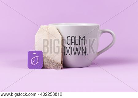 Concept For Calming Herbal Tea With Tea Bag With Leaf On Labelnext To Tea Cup With Text 'calm Down'