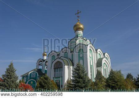Volzhsky, Volgograd Region, Russia - October, 2020: Orthodox Church Of Seraphim Sarov. Cross On Gold