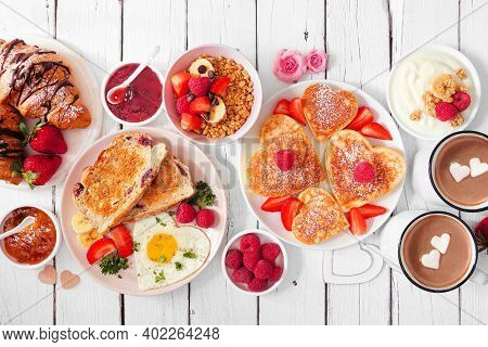 Valentines Or Mothers Day Brunch Table Scene. Top View On A White Wood Background. Heart Shaped Panc