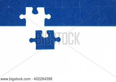 Piece Of Blue Jigsaw Puzzle On A White Background, The Concept Of The End Of A Big Hard Work, The So