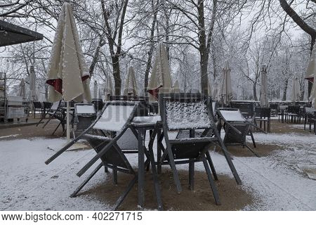 Madrid, Spain - January 07, 2021: Tables And Chairs On A Terrace, Collected, Without Customers, In T