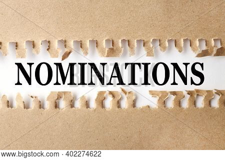 Nominations, Text On White Paper Over Torn Paper Background