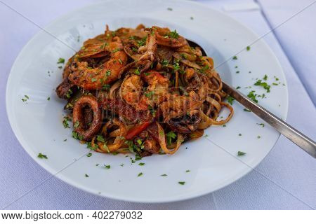 Colorful Spaghetti With Seafood. Traditional Mediterranean Dish, Tavern In Chora, Old Town. Folegand