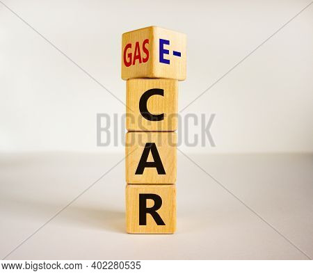 Gas Car Or E-car Symbol. Turned A Cube And Changed Words 'gas Car' To 'e-car'. Beautiful White Backg