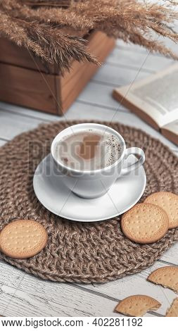 Cap Of Coffee And Cookies On Wicker Jute Placemat