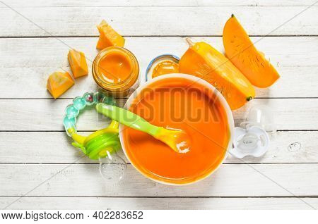 Baby Food. Puree From Fresh Pumpkin. On A White Wooden Background.