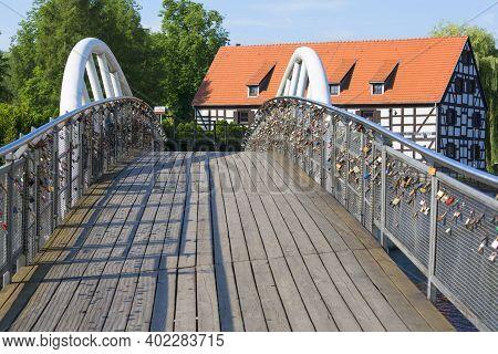 Bydgoszcz, Poland - June 26, 2020: Footbridge, Bridge Of Lovers Over Brda River On Mill Island