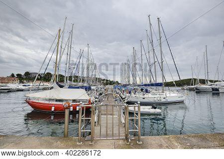 Rovinj, Croatia - May 22, 2018: Pier And Yachts In Coastal Town Of Rovinj, Istria, Croatia. Seascape