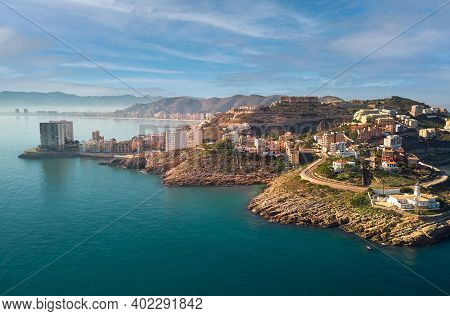 Aerial Drone Point Of View Cullera Townscape Rooftops During Sunny Winter Day. Touristic Famous Plac