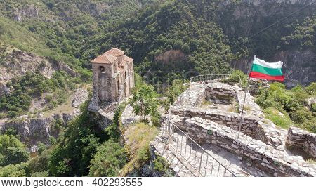 Bulgarian Medieval Fortification Structure To Visit On A Hill. Balkan Stronghold And Antique Scenery
