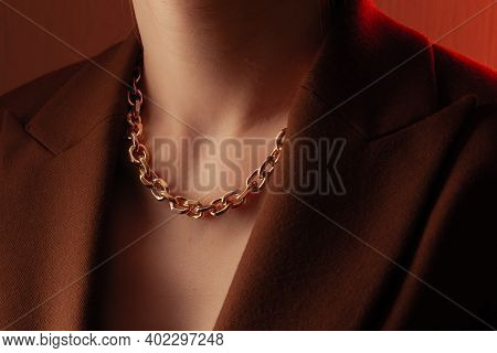 Cropped Close Up Portrait Of Young Woman With Perfect Silky Skin, Demonstrating Golden Jewelry Chain