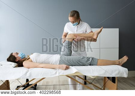 Knee Injury Rehab Massage And Physiotherapy In Face Mask