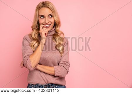 Portrait Of Beautiful Joyous Woman Smiling And Looking Upward At Copyspace Isolated Over Pink Backgr
