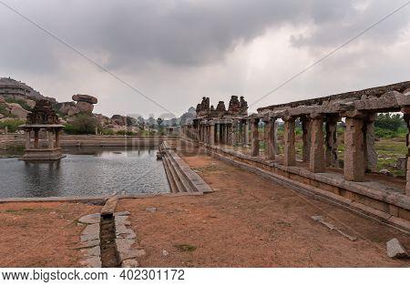 Hampi, Karnataka, India - November 5, 2013: Sri Krishna Tank In Ruins. South Side Of Pool With Shrin