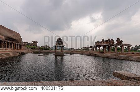 Hampi, Karnataka, India - November 5, 2013: Sri Krishna Tank In Ruins. Wide Angle Shot Of Shrine In