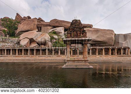 Hampi, Karnataka, India - November 5, 2013: Sri Krishna Tank In Ruins. Brown Stone Damaged Shrine In