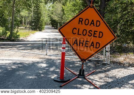 Road Closed Ahead Sign Keeps People From Entering Campground On Gravel Road
