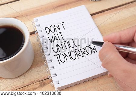 Dont Wait Until Tomorrow, Text Words Typography Written On Book Against Wooden Background, Life And