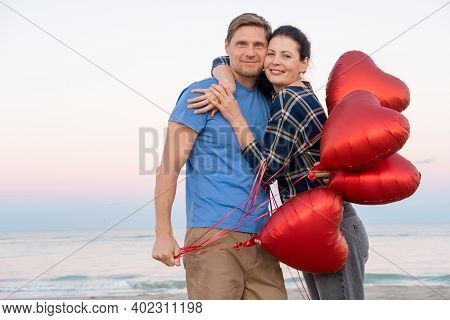 Couple In Love Going Out On Dates, Walking On The Beach With Heart-shaped Balloons. Happy Valentines