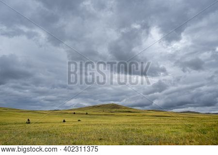 Scenic View Of Beautiful Green Hills And Mountains With Stormy Cloudy Sky On Olkhon Island, Russia.
