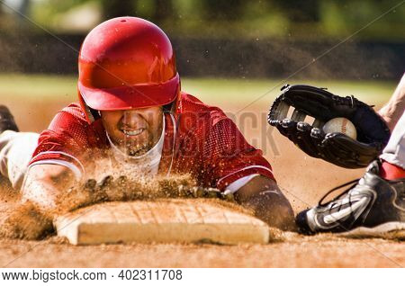 Portrait of man stealing base in baseball