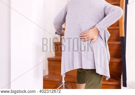 Elderly Woman Suffering From Low-back Lumbar Pain While Walking On Stair At Home,low Back Pain Lumba