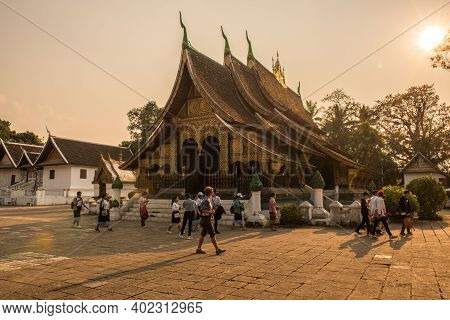 Luang Prabang, Laos : March-01-2019 : Group Of Tourist Visiting Wat Xieng Thong An Iconic Temple In