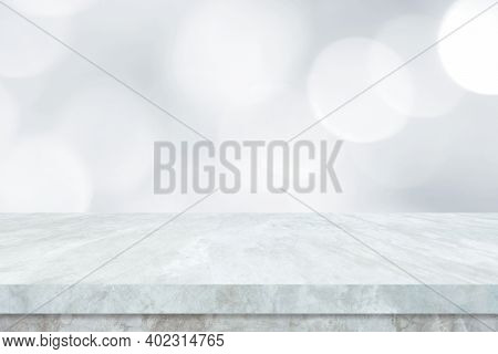 Empty White Table Top, Counter, Desk Over Blur Perspective Store With Bokeh Light Background, White