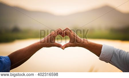 Love And Valentine Day Concept. A Happy Senior Couple Showing Heart Sign, Love Symbol, Happy Marriag
