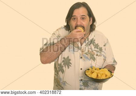 Fat Caucasian Man Eating Mouthful Of Chips Ready For Vacation