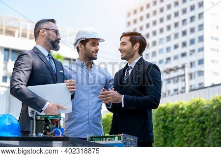 Business People Talk To Electrical Engineer Technician Of Renewable Energy Working On An Innovative