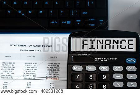 Calculator With The Word Finance On The Display. Money, Finance And Business Concept
