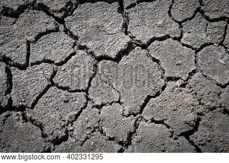 Dried And Cracked Soil With Grass. Concept Drowth And Erosion.