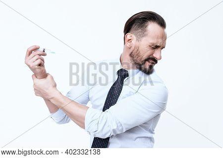 A Man's Arm Hurts.