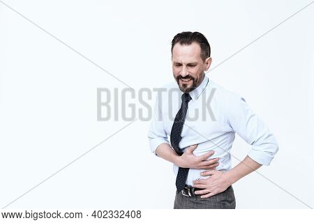 A Young Man Has A Stomach Ache.