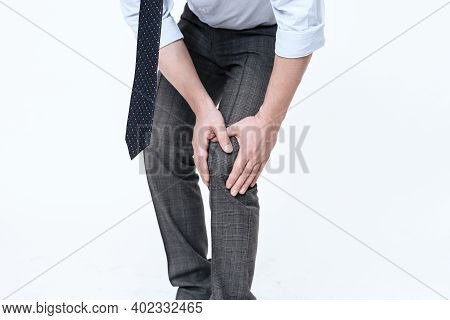 A Young Man Has A Pain In His Leg.