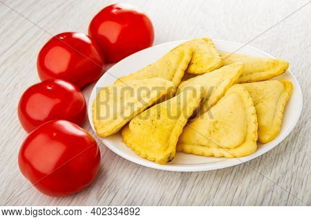 Red Tomatoes, Small Savory Pies In Glass White Saucer On Wooden Table